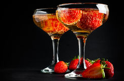 Two glasses of cold champagne with strawberries Stock Images