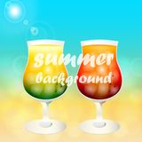 Cold drinks on a sea background. Two glasses of cold drink on the sand in the tropics Royalty Free Stock Image