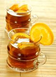 Two glasses with cold tea and fresh oranges Stock Images