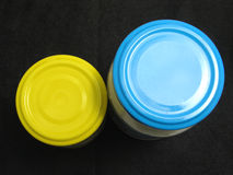 Two glasses with colored lids Royalty Free Stock Photography