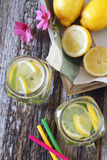 Two glasses of cool refreshing drink: pure water,  lemon and min Royalty Free Stock Photos