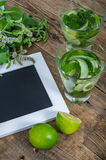 Two glasses with cucumber and mint drink and empty frame Stock Image