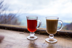 Two glasses,cup of red and milk hot drink.couple drinking hot co. Ffee and tea, coffee, tea, relax in the mountains, Carpathians,close-up Stock Photography