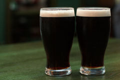 Two glasses of dark beer Royalty Free Stock Photos