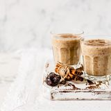 Date Milkshake with Cinnamon. Two Glasses of Date Milkshake with Cinnamon, copy space for your text, square Royalty Free Stock Photo