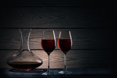 Two glasses and decanter of red wine on dark background Stock Image