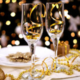 Two glasses on the decorated table for Christmas. Two glasses on new year and christmas the decorated table Royalty Free Stock Image