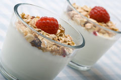 Two glasses of deliciously fresh yogurt and muesli Royalty Free Stock Photography