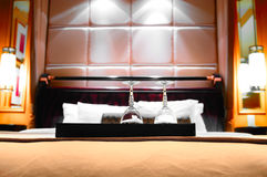 Two glasses on the double bed Royalty Free Stock Photography