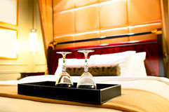 Two glasses on the double bed Royalty Free Stock Images