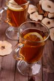 Two glasses of dried fruit tea. On the wooden table Stock Photography