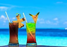 Two glasses of drink on a beach table Royalty Free Stock Images