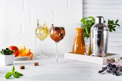 Two glasses with drink and Cocktail shaker for preparing a summer cocktail with a place for your subject and text. Two glasses with drink, Orange lemonade in the royalty free stock photos