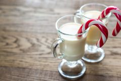 Two glasses of eggnog with candy canes Royalty Free Stock Photos