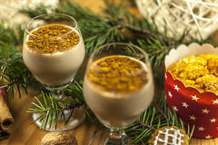 Two glasses of eggnog. On wooden background Stock Photo