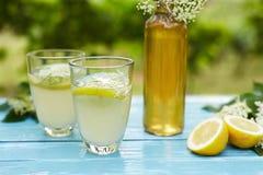 Two glasses of elderflower lemonade and bottle Royalty Free Stock Image