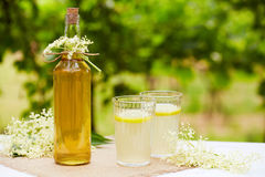 Two glasses of elderflower lemonade and bottle Royalty Free Stock Images