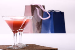 Two glasses & evening-party. Two glasses stands on a background Packages atmosphere of evening-party stock image