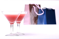 Two glasses & evening-party. Two glasses stands on a background Packages atmosphere of evening-party stock images