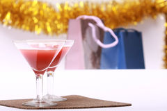Two glasses & evening-party. Two glasses stands on a background Packages atmosphere of evening-party royalty free stock photos