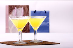 Two glasses & evening-party. Two glasses stands on a background Packages atmosphere of evening-party royalty free stock images