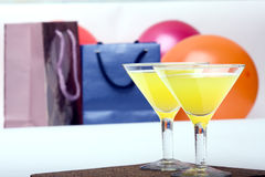 Two glasses & evening-party. Two glasses stands on a background Packages atmosphere of evening-party royalty free stock photography