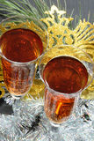 Two glasses in festive tinsel tinsel and mask Royalty Free Stock Photo