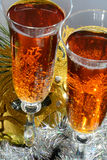 Two glasses in festive tinsel tinsel and mask Stock Image