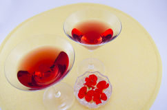 Two glasses filled with red drink Stock Photos