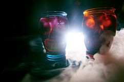 Two glasses in the form of skulls of different colors stock image