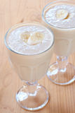 Two glasses of fresh banana smoothies Stock Photo
