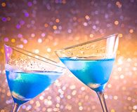 Two glasses of  fresh blue cocktail with ice make cheers Royalty Free Stock Photos