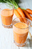 Two glasses of fresh carrot juice Royalty Free Stock Photos