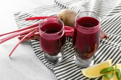 Two glasses of fresh homemade smoothie with some ingredients. On table Royalty Free Stock Photos