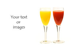 Two glasses of fresh red and yellow fruit juice. With room for your text or images stock images