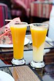 Two glasses of freshly squeezed juice. And tubes Stock Photography