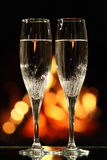 Two glasses in front of fireplace Royalty Free Stock Images