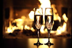 Two glasses in front of fireplace. Closeup view of the two glasses in front of fireplace Royalty Free Stock Images