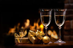 Two glasses in front of fireplace Royalty Free Stock Photography