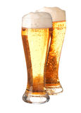 Two glasses of frothy beer Stock Images