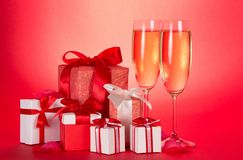 Two glasses, gift boxes with bows Stock Photo