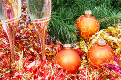 Two glasses with gold Xmas decorations and tree 8 Royalty Free Stock Photography