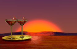Two glasses on golden plate with romantic sunset on background Stock Images