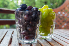 Two glasses of grape Stock Image