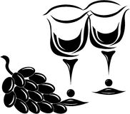 Two glasses with grapes. Two black wine glasses with black grapes Stock Images