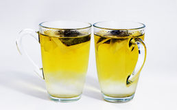 Two glasses of green tea Stock Photos