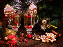 Two glasses of grog, decoration Christmas cookies. Royalty Free Stock Photos