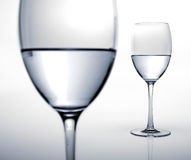 Two glasses half filled of water. Royalty Free Stock Image