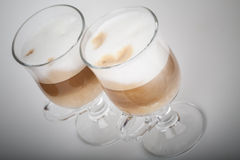 Two glasses with handles of latte coffee Stock Photo