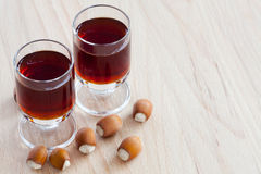 Two glasses with hazelnut liqueur Royalty Free Stock Photography